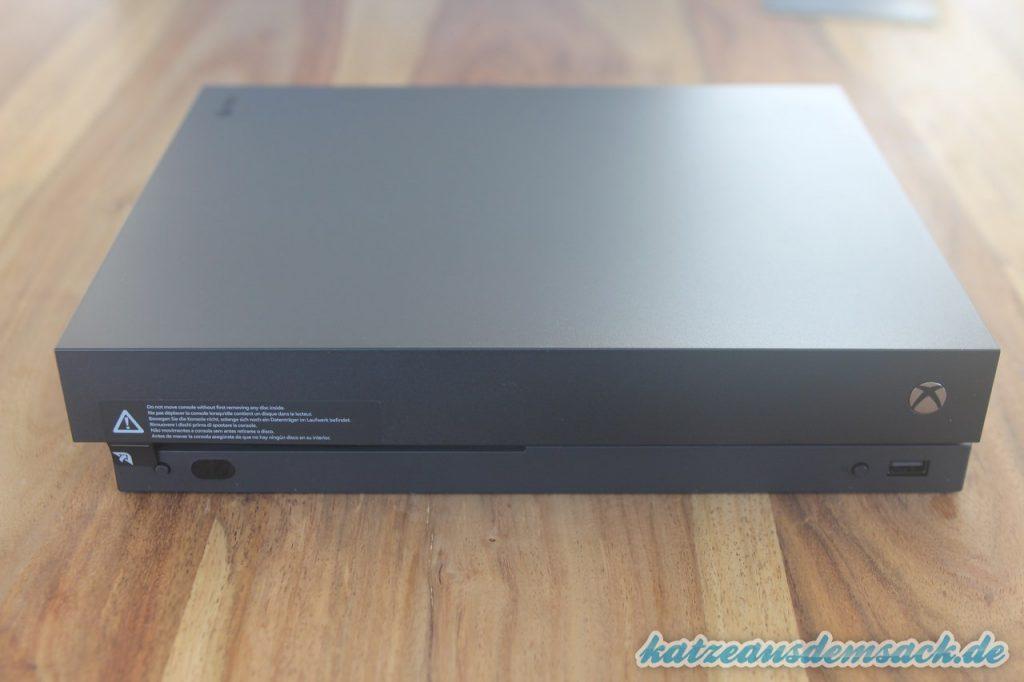 Xbox One X - nicht mit CD im Laufwerk bewegen